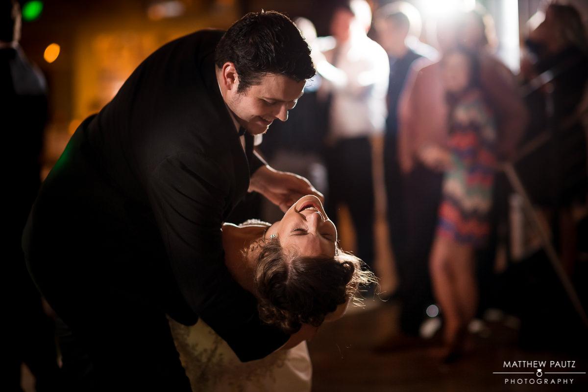 Groom dips bride at wedding reception