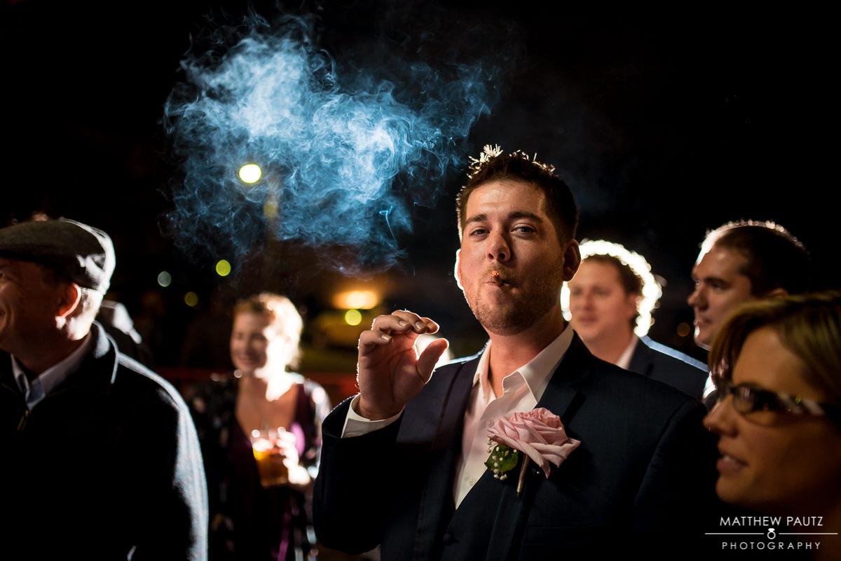 Groomsman smoking at night