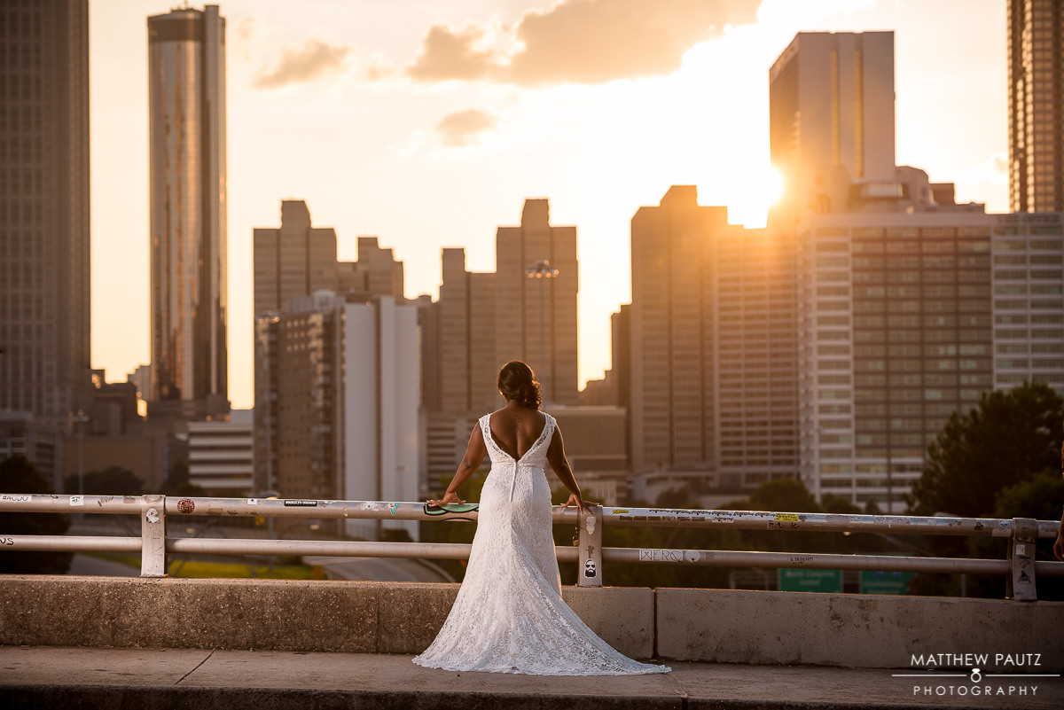Bride in wedding dress looking out over atlanta ga