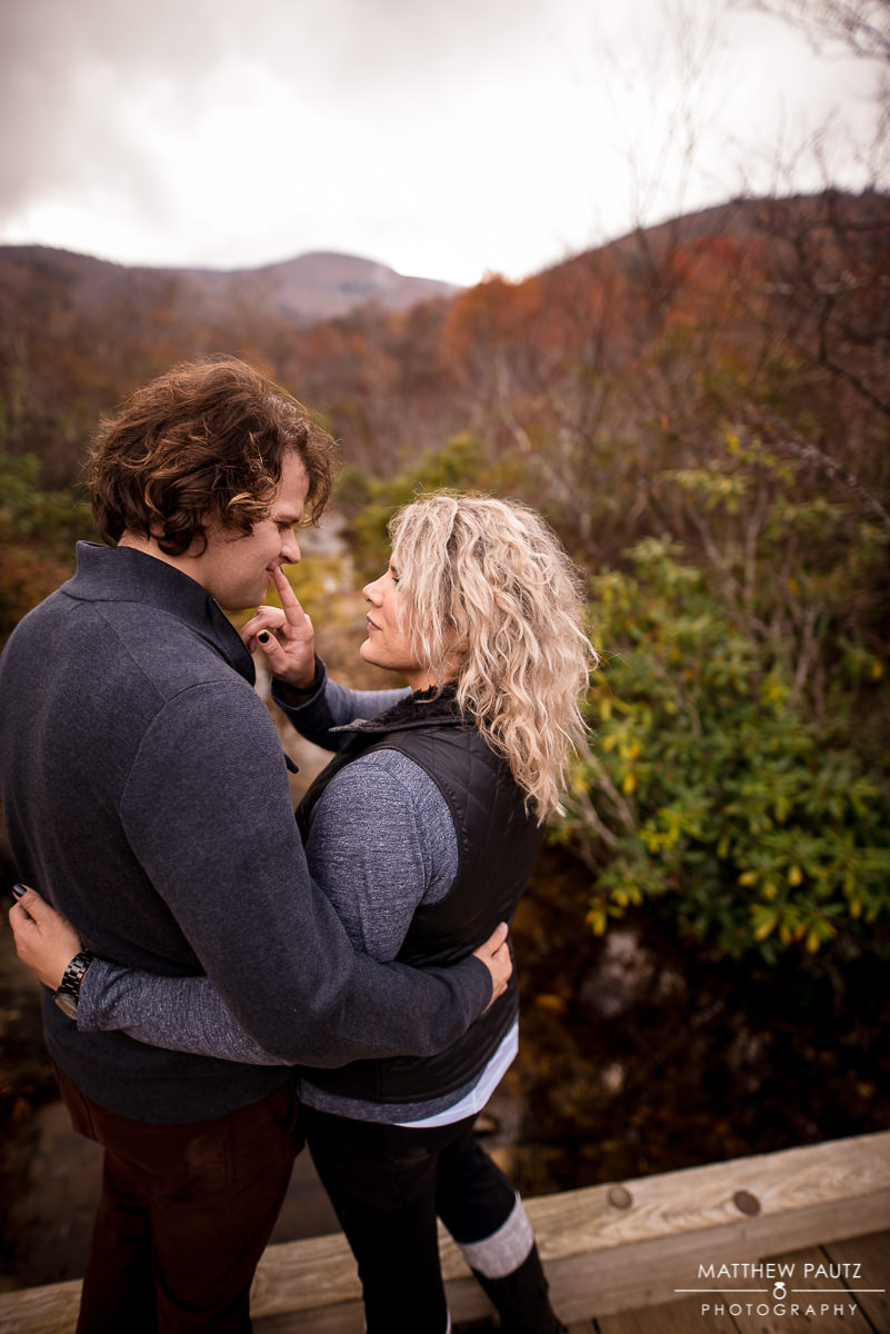 Engaged couple in the mountains during Fall