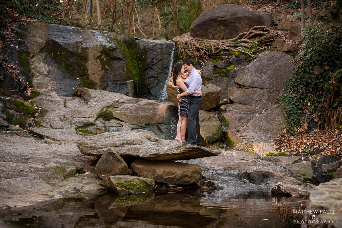 Couple taking engagement photos in Falls Park