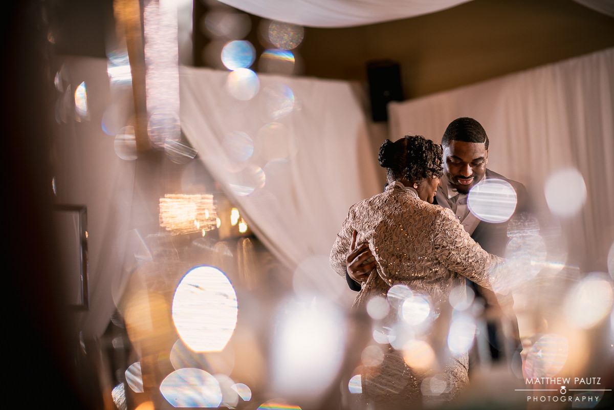 Groom dancing with his mother at wedding reception