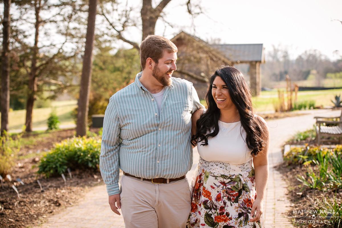 couple walking side by side in an botanical garden