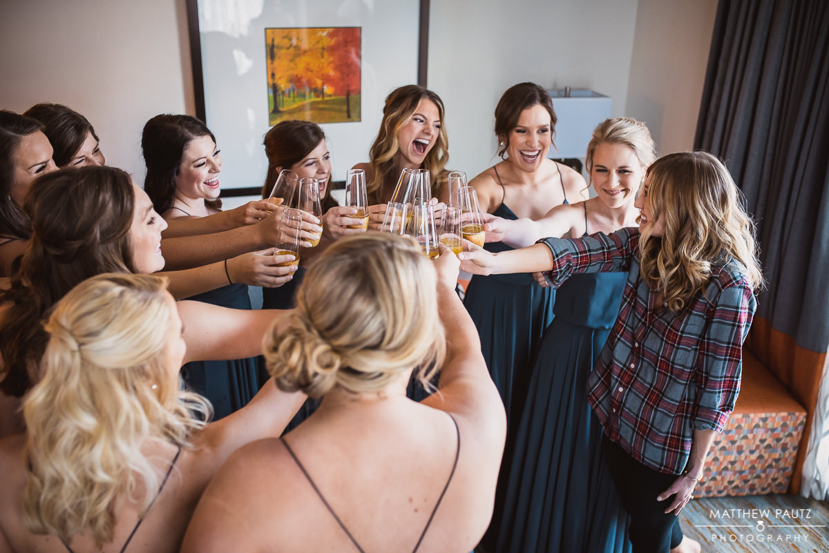 Bride toasting champagne with bridesmaids before wedding in Greenville SC