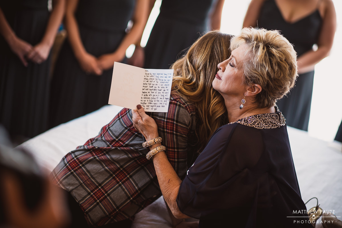 Bride hugs mother before wedding