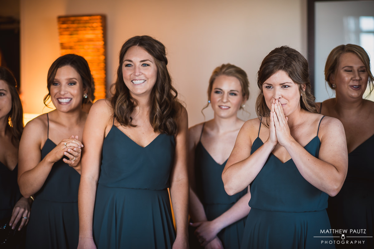 Bridesmaids see bride in dress for first time