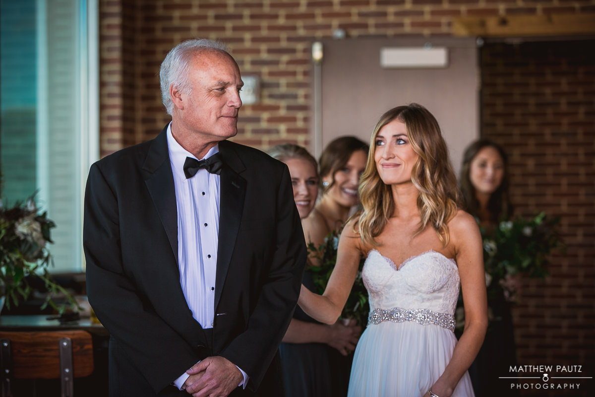 Father of bride sees daughter before wedding