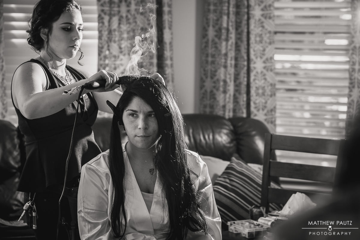 Bride getting hair styled before wedding at bnb