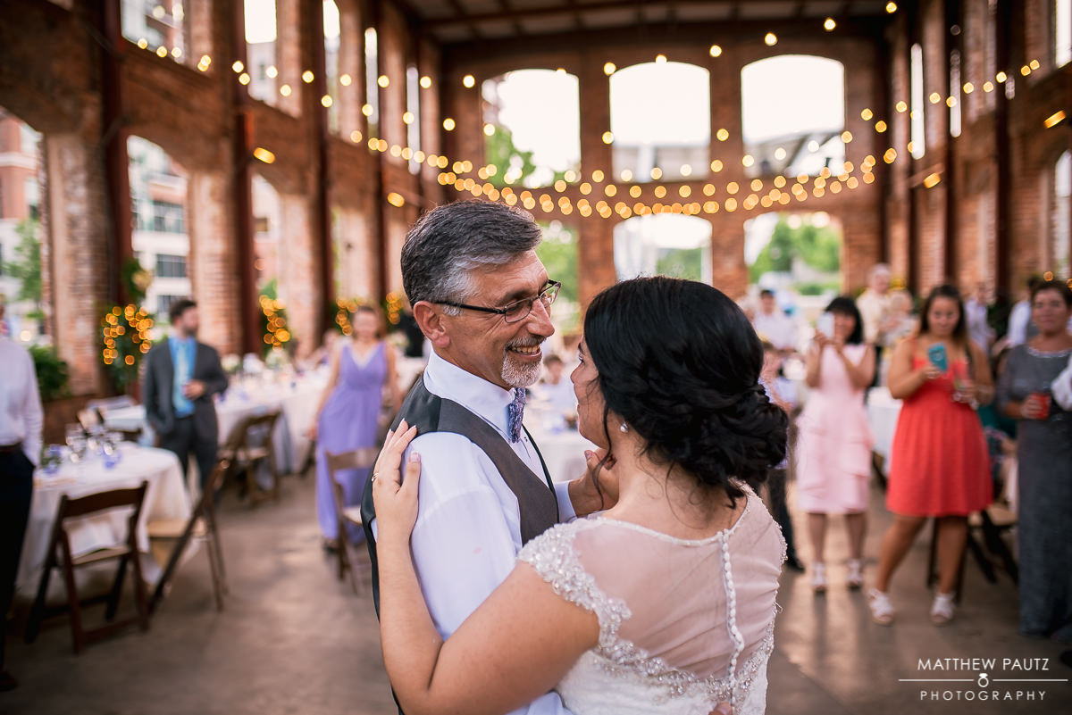 father of bride dancing with father at wedding reception
